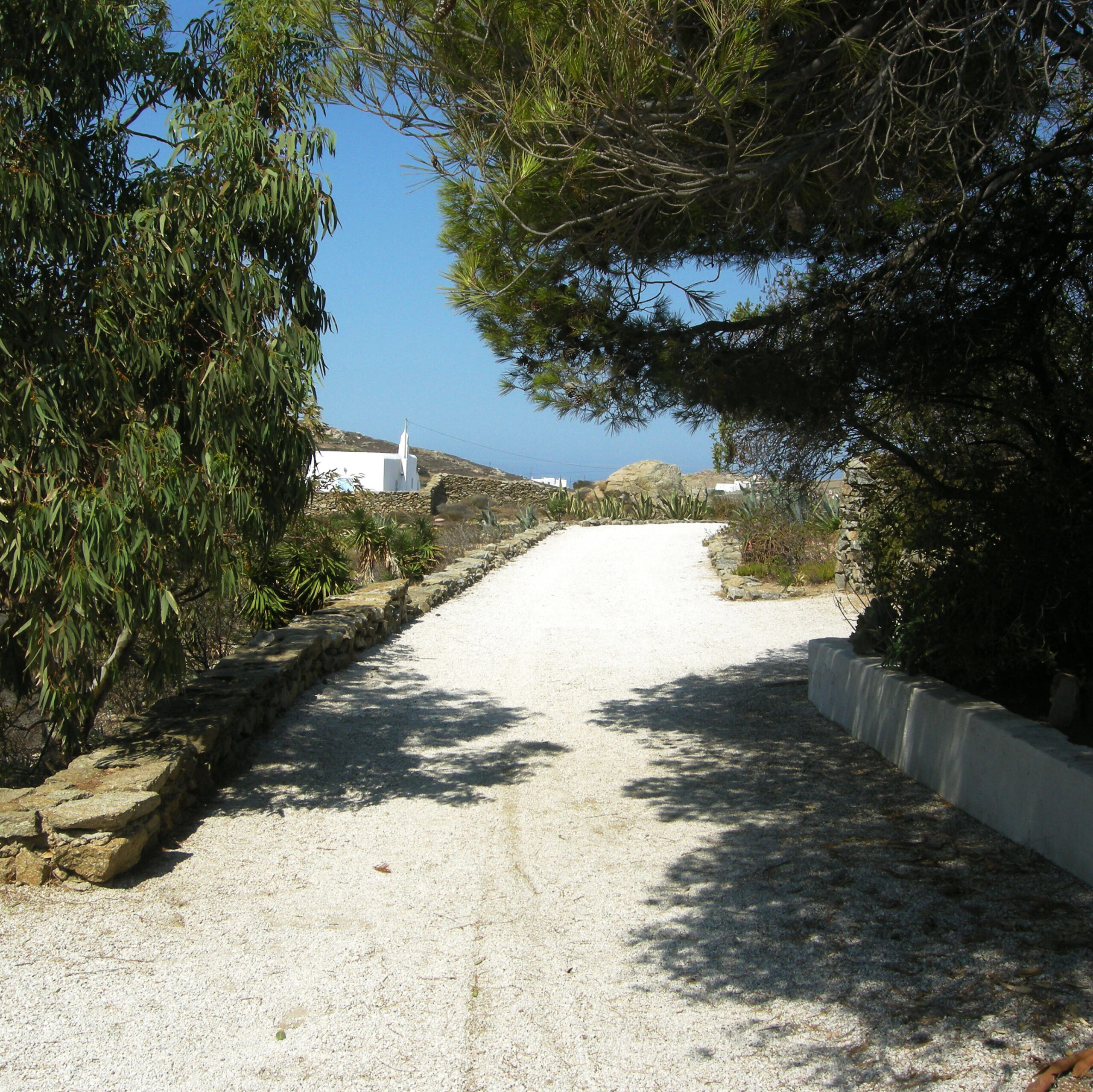 impressive secluded gravel way to the villa